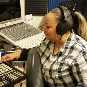 Angela Rowan, respiratory care practitioner, pictured here in a recording studio