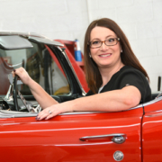 Picture of Mary Mittwede, a respiratory care professional credentialed by the NBRC, sitting in a vintage corvette