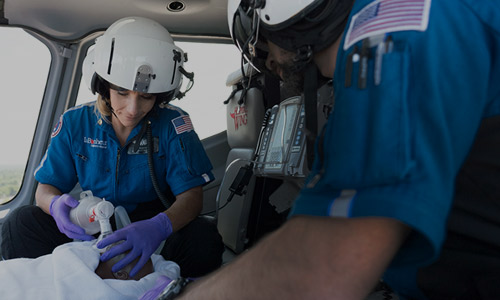 A neonatal/pediatric respiratory therapist in flight